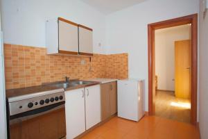 Apartment Tucepi 13056a, Apartmány  Tučepi - big - 12