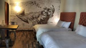 Отель Piki Hotel y Hostal, Чолула