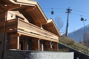 Üna Lodge - Hotel - Le Châble