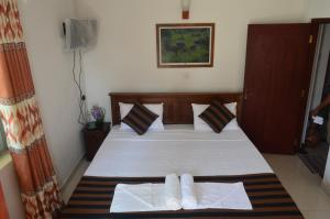 Induruwa Beach Villa, Отели  Бентота - big - 27