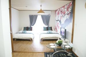 Sakura Apartemnt 0-13, Nyaralók - Oszaka