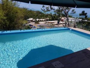 Paddons, Holiday homes  Airlie Beach - big - 17