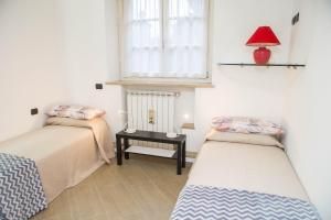 RHO Blumarine Apartment, Apartmanok  Rho - big - 42