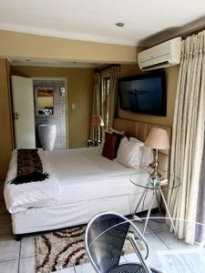 Saffron Guest House, Гостевые дома  Йоханнесбург - big - 2
