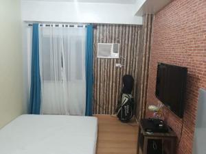 Condo studio type, Проживание в семье  Манила - big - 2