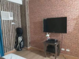Condo studio type, Проживание в семье  Манила - big - 7