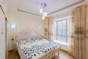 Flowers & Fruits Three-Bedroom Apartment, Apartmány  Kuej-jang - big - 45