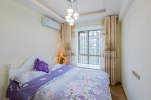 Flowers & Fruits Three-Bedroom Apartment, Apartmány  Kuej-jang - big - 41