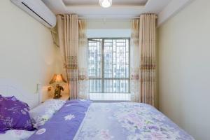 Flowers & Fruits Three-Bedroom Apartment, Apartmány  Kuej-jang - big - 39