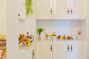 Flowers & Fruits Three-Bedroom Apartment, Apartmány  Kuej-jang - big - 33