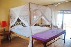 Villa Volandrella - in front of Watamu Beach, Dovolenkové domy  Watamu - big - 9