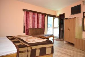 Hotel Dogra Residency Patnitop, Szállodák  Udhampur - big - 17