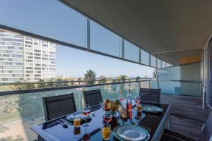 Foto Unique Rentals-Seafront Luxe Suites
