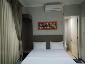 Mini Guest House Tasikmalaya, Bed and breakfasts  Tasikmalaya - big - 3