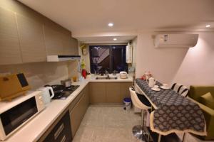 Theone House, Апартаменты/квартиры  Гуанчжоу - big - 9