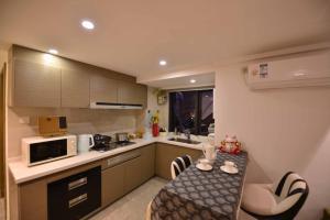 Theone House, Апартаменты/квартиры  Гуанчжоу - big - 18