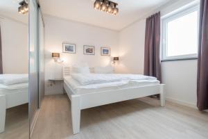 Ferienwohnungen Rosengarten, Апартаменты  Бёргеренде-Ретвиш - big - 242
