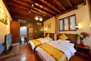 Yujian Zunxiang Guest House, Ubytování v soukromí  Lijiang - big - 1