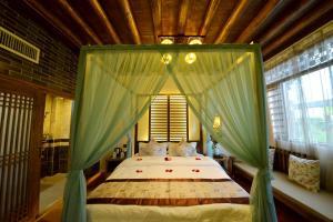 Yujian Zunxiang Guest House, Homestays  Lijiang - big - 17