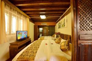 Yujian Zunxiang Guest House, Homestays  Lijiang - big - 15