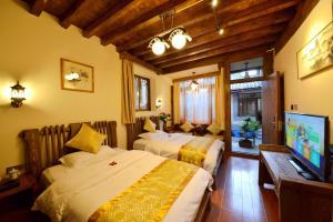 Yujian Zunxiang Guest House, Ubytování v soukromí  Lijiang - big - 7