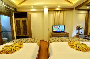 Yujian Zunxiang Guest House, Ubytování v soukromí  Lijiang - big - 4