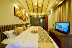 Yujian Zunxiang Guest House, Homestays  Lijiang - big - 2