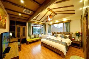 Yujian Zunxiang Guest House, Homestays  Lijiang - big - 31
