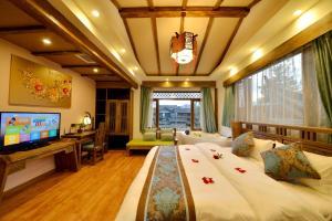 Yujian Zunxiang Guest House, Ubytování v soukromí  Lijiang - big - 36