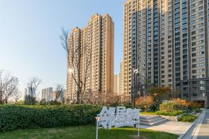 Annie's Home Apartment, Апартаменты  Цзинань - big - 6
