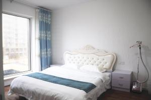 WeiHai Emily Seaview Holiday Apartment International Bathing Beach, Ferienwohnungen  Weihai - big - 12