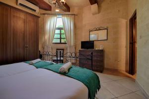 Ta Tumasa Farmhouse, Отели типа «постель и завтрак»  Надур - big - 47