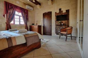 Ta Tumasa Farmhouse, Отели типа «постель и завтрак»  Надур - big - 52