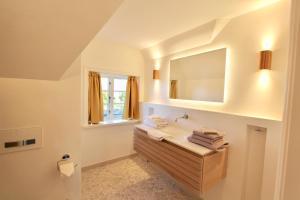 Ulenhof Appartements, Ferienwohnungen  Wenningstedt-Braderup - big - 61