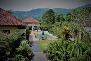 Villa Kendi, Комплексы для отдыха с коттеджами/бунгало  Kalibaru - big - 41