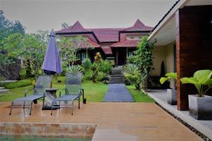 Villa Kendi, Комплексы для отдыха с коттеджами/бунгало  Kalibaru - big - 36