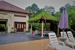 Villa Kendi, Комплексы для отдыха с коттеджами/бунгало  Kalibaru - big - 35