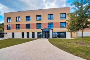 Location gîte, chambres d'hotes Zenitude Hôtel-Résidences Magny-les-Hameaux dans le département Yvelines 78
