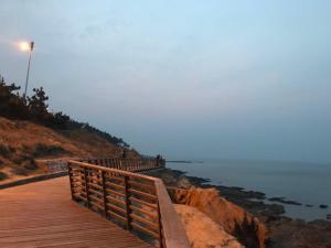 WeiHai Emily Seaview Holiday Apartment International Bathing Beach, Ferienwohnungen  Weihai - big - 17