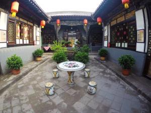 Pingyao Ancient City Zhengxin Caotang Inn, Penzióny  Pingyao - big - 17