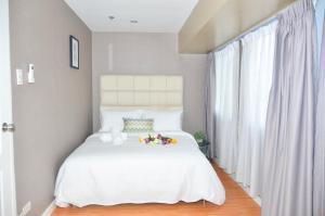 Oasis Regency @ Fort Victoria BGC, Апартаменты  Манила - big - 66
