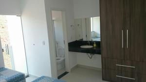 Apartamento Mirante de Escarpas, Apartments  Capitólio - big - 69