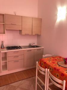 Appartamento Nel Residence Poseidone - AbcAlberghi.com