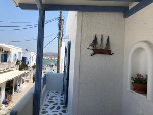 House with port view Antiparos Greece