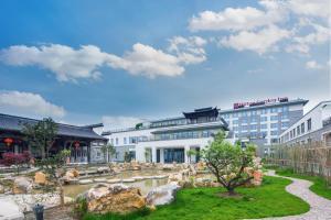 Albergues - Hilton Garden Inn Qidong
