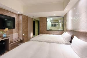 Shui Sha Lian Hotel, Szállodák  Jücsi - big - 23