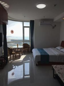 Weihai Emily's Holiday Apartment, Апартаменты  Вэйхай - big - 13