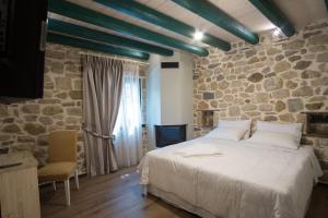Deluxe Δίκλινο Δωμάτιο - με 1 διπλό ή 2 μονά κρεβάτια - με Μπανιέρα-Υδρομασάζ