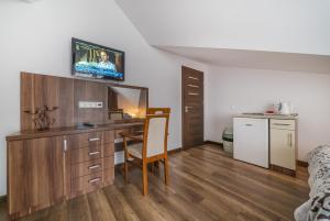 Pokoje i Apartamenty Poducha