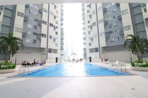 Oasis Regency @ Fort Victoria BGC, Ferienwohnungen  Manila - big - 151